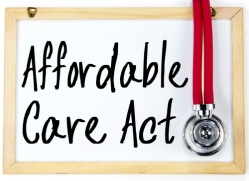 affordable care act text write on blackboard